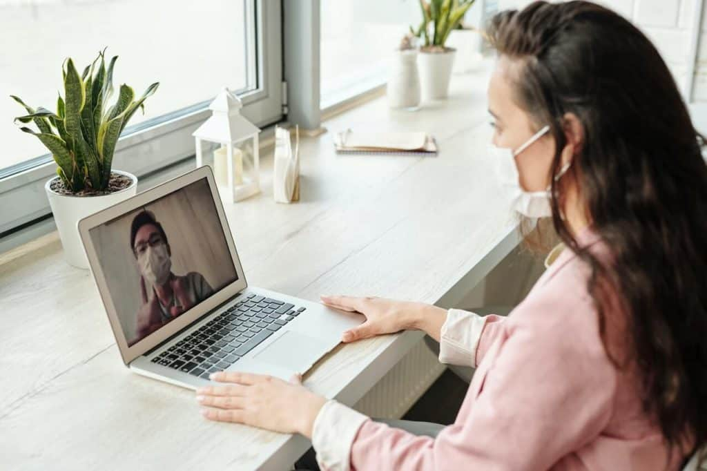 woman with mask on video call